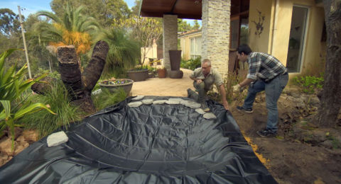Installing AQUAPRO PVC Pond Liner - Securing with rocks